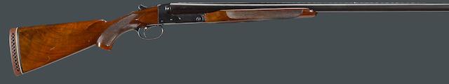 A 12 gauge Winchester Model 21 boxlock ejector gun