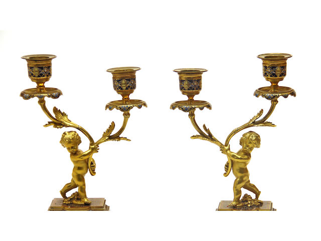 A pair of French gilt bronze and champlevé enamel figural two light candelabra