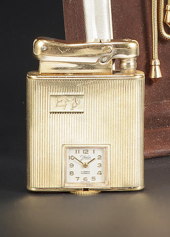 Swiss. A 14K gold cigarette lighter with watch.1930's