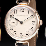 H'y Moser & Cie. A 14K rose gold early large wristwatch for the Russian marketEarly 20th century, t