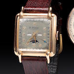 Le Phare. An 18K rose gold square center seconds wristwatch with triple calendar and moon phasesCase no 142963/4404, mid 20th century