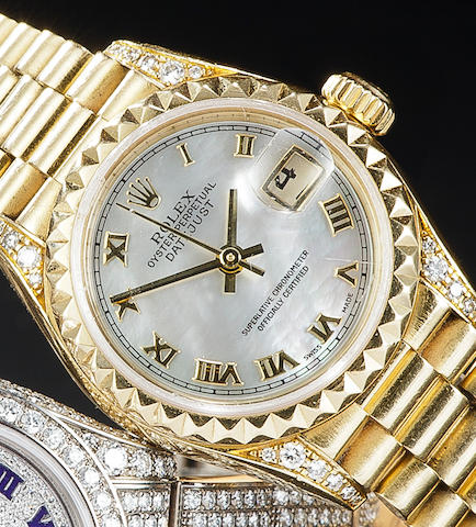 Rolex. An 18K gold lady's diamond set automatic mother of pearl dial center seconds wristwatch with date and braceletOyster Perpetual Datejust, Ref:79188, Case no. A660890, circa 1998