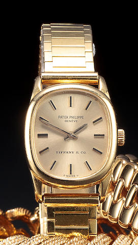 Patek Philippe. A fine 18K gold lady's wristwatch and braceletRetailed by Tiffany & Co, Ref. 4201, Case no. 2719496, Movement no. 1261370, 1970's