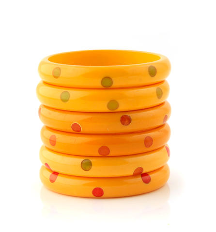 "A group of six cream Bakelite ""dot"" bangle bracelets"
