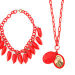 Two red Bakelite necklaces: fringe pepper and cameo locket with chain