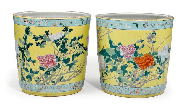 A pair of polychrome enameled porcelain jardinières