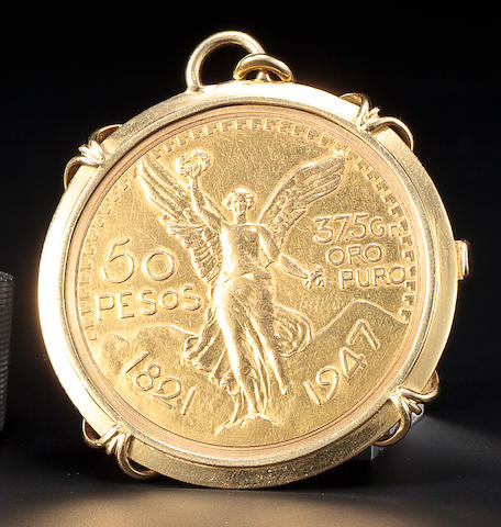 Piaget. An 18K gold pendant watch within a 50 peso coinMovement no. 6491189