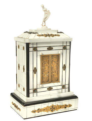 A Continental gilt metal mounted ivory veneered and ebonized automaton music box