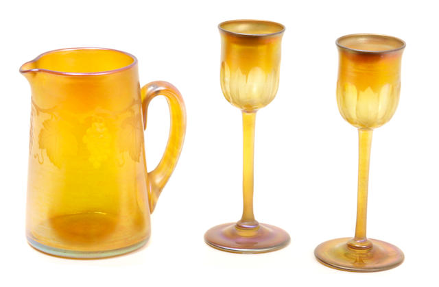 Two L.C. Tiffany Favrile glass liqueurs and an engraved glass small pitcher