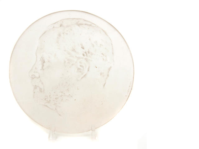 An R. Lalique molded glass portrait plaque