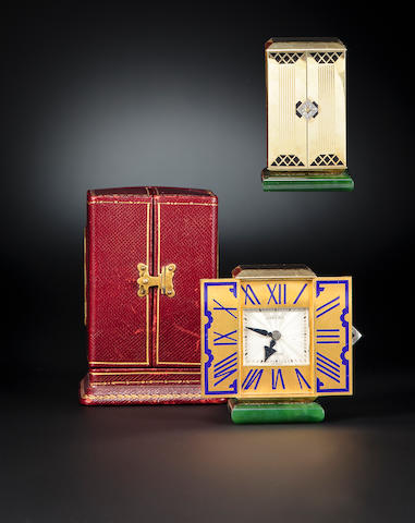 "Cartier, Paris. A very fine and rare Art Deco 18K enameled gold gem-set triptych desk clockMovement No. 28974, inscribed ""Cadran Breveté"", case stamped with reference no. 1714, each door stamped 112, the case with French lozenge maker's mark, VR&Cie. with roman numeral XII, circa 1928"
