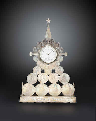 A remarkable desk clock made from United States silver coinsInscribed and dated 1878, presented to Theodore Cuyler and his wife Annie on their 25th wedding anniversary.