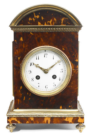 A Neoclassical style gilt brass mounted tortoiseshell mantel clock <BR />late 19th/early 20th century