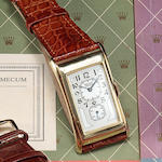Jaeger LeCoultre. An unusual 18K gold center seconds alarm wristwatch with parking time reminderCas