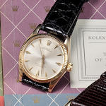 A group of Rolex spare parts catalogs and watch material