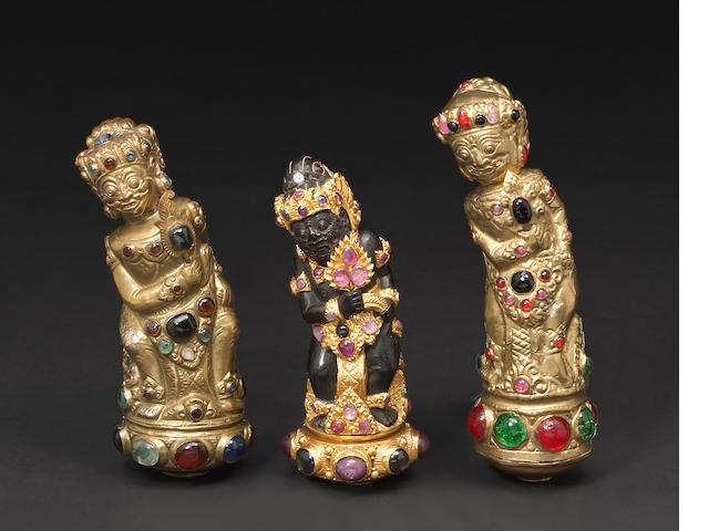 A lot of three Balinese figural keris hilts