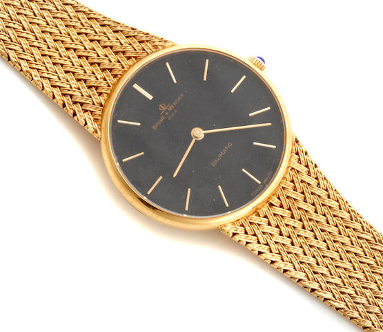 An 18k gold automatic bracelet wristwatch, Baume & Mercier