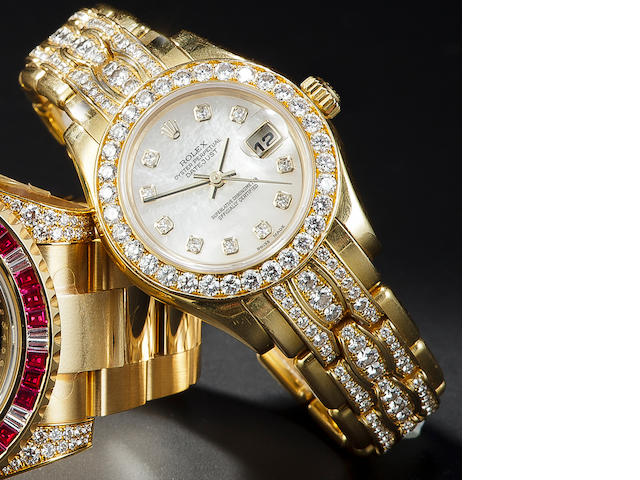 Rolex. A fine lady's 18K white gold automatic bracelet watch pave-set with diamondsOyster Perpetual