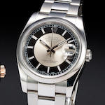 Rolex. A fine stainless steel automatic center seconds calendar bracelet watch with two tone dialOy