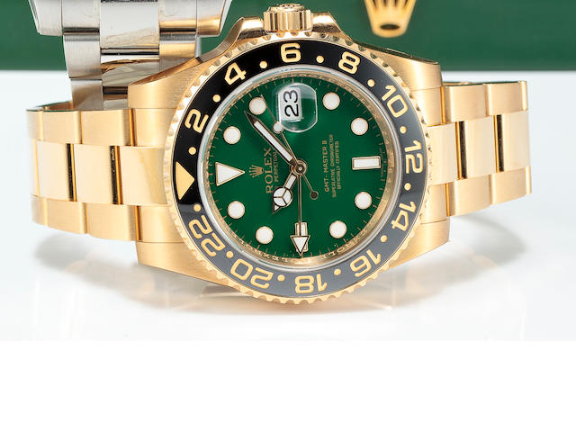 Rolex. A fine 18K gold automatic green dial dual time zone center seconds bracelet watch with dateG
