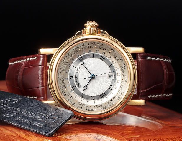 "Breguet. A fine 18K gold automatic center seconds wristwatch with world time indications and date""Hora Mundi Marine"" Ref:3700, No. 1286 M, circa 2000"