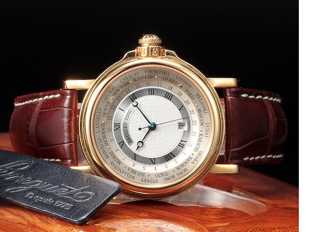 "Breguet. A fine 18K gold automatic center seconds wristwatch with world time indications and date""H"