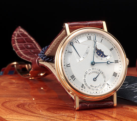 Breguet. A fine 18K rose gold automatic wristwatch with power-reserve, date and phases of the moonClassique, Ref:3137, No. 2159 M, Movement no. 12066