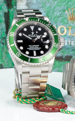 Rolex. A fine stainless steel automatic center seconds diver's bracelet watch with date and green bezelOyster Perpetual Date Submariner, Ref:16610, No. F 026558, sold 2003