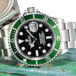 Rolex. A fine stainless steel automatic center seconds diver's bracelet watch with date and green b