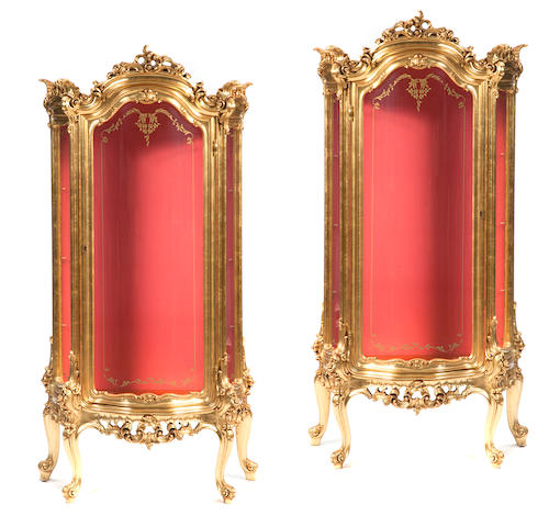 A pair of Louis XV style giltwood vitrines