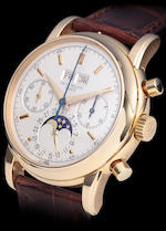 Patek Philippe. A fine and rare 18K gold chronograph wristwatch with perpetual calendar and moon phasesRef:2499 / 100, Case no. 2779166, Movement no. 869405, sold 1980
