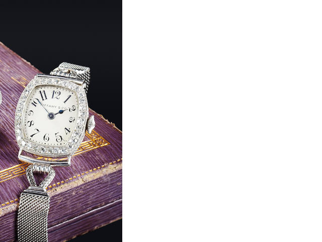 Tiffany & Co., New York. A fine early lady's platinum and diamond wristwatch with platinum bracelet