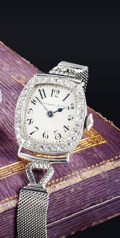 Tiffany & Co., New York. A fine early lady's platinum and diamond wristwatch with platinum bracelet