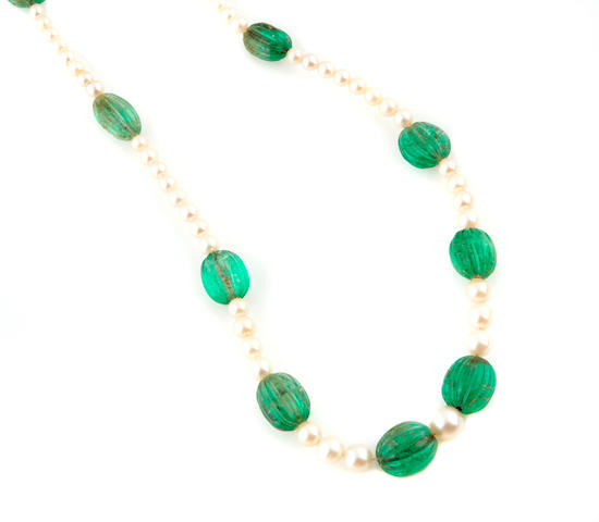 A carved emerald bead and cultured pearl necklace