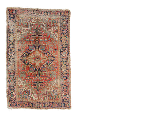 A Heriz carpet size approximately 7ft. 1in. x 10ft. 1in.