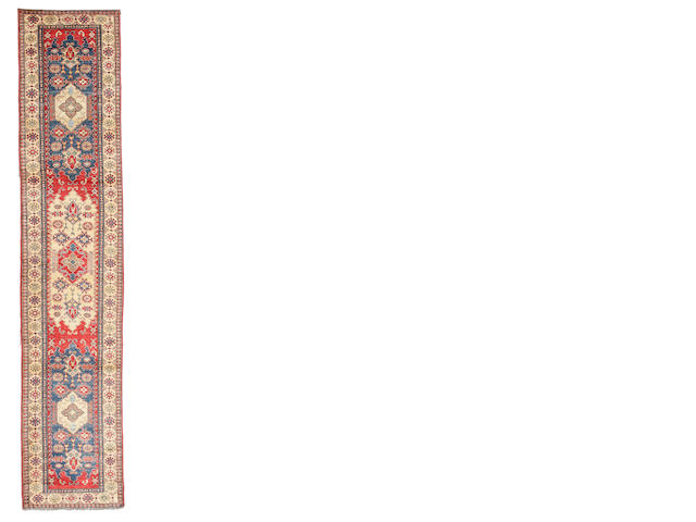 A Pakistani runner size approximately 2ft. 8in. x 11ft. 11in.
