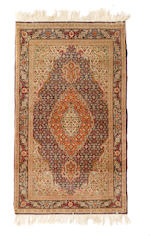 A Pair of Tabriz rugs sizes approximately 3ft. 4in. x 5ft. 2in.