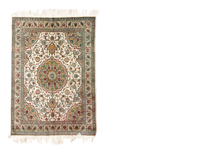 A Tabriz rug size approximately 4ft. 9in. x 6ft. 4in.