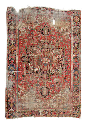 A Heriz carpet  size approximatley 8ft. 9in. x 11ft. 7in.