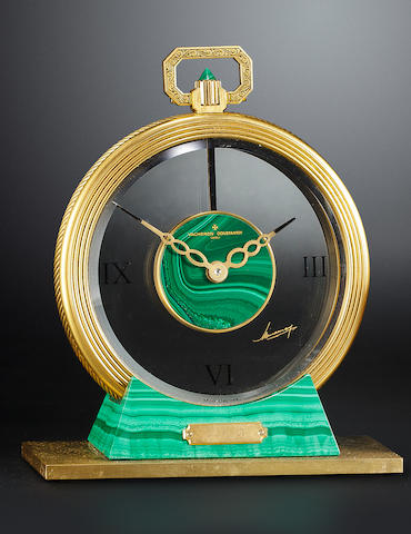 A brass and malachite mantle clock with a stand and wood box **IN ON INSPECTION**
