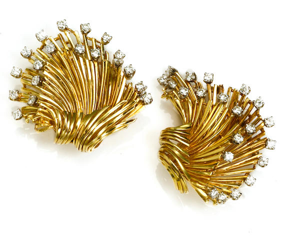 Two diamond and fourteen karat bicolor gold spray brooches