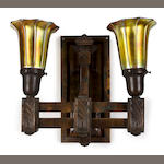 A pair of Arts & Crafts patinated metal two-arm sconces with Steuben aurene glass shades circa 1910