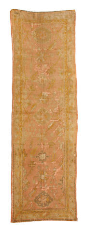 An Oushak runner West Anatolia, late 19th century approximate size 12ft 2in x 4ft 2in (371 x 127cm)