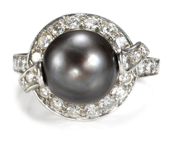 A colored cultured pearl and diamond ring