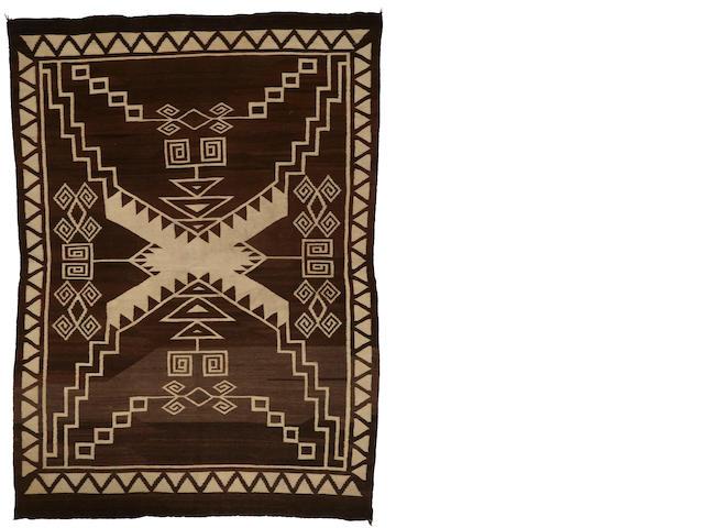 A Navajo storm pattern rug