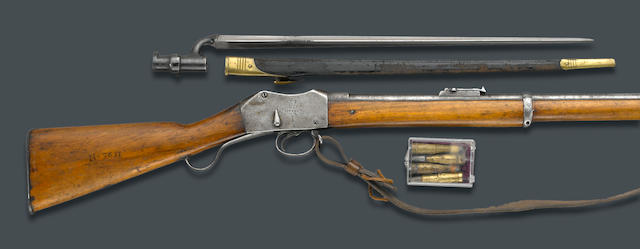 A Zulu War period British Martini-Henry MKII breechloading rifle with bayonet and four cartridges