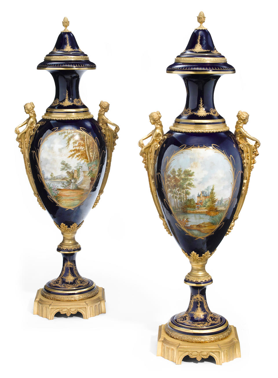 An imposing pair of Sèvres style porcelain gilt bronze mounted covered urns  20th century