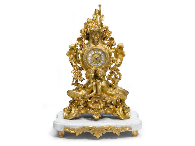An imposing French gilt bronze mantel clock on marble base