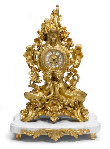 A Louis XV style gilt bronze mantel clock  late 19th century