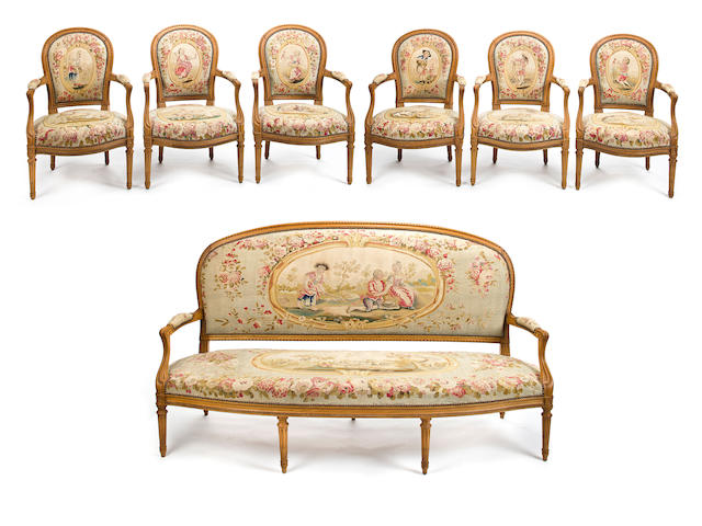 A Louis XVI style beechwood salon suite late 19th/early 20th century
